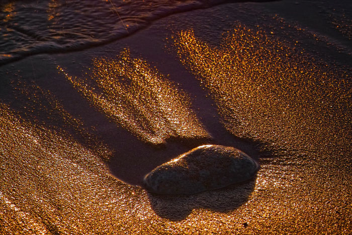 beach sand at sunset