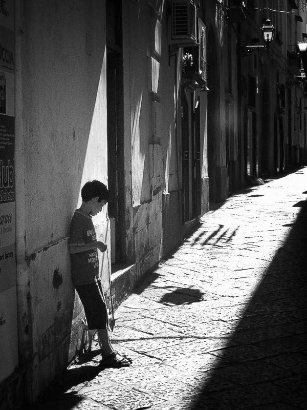 boy in an alley in sorento Italy