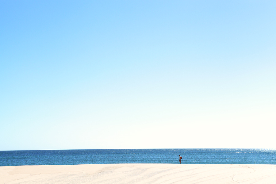 man alone on a beach