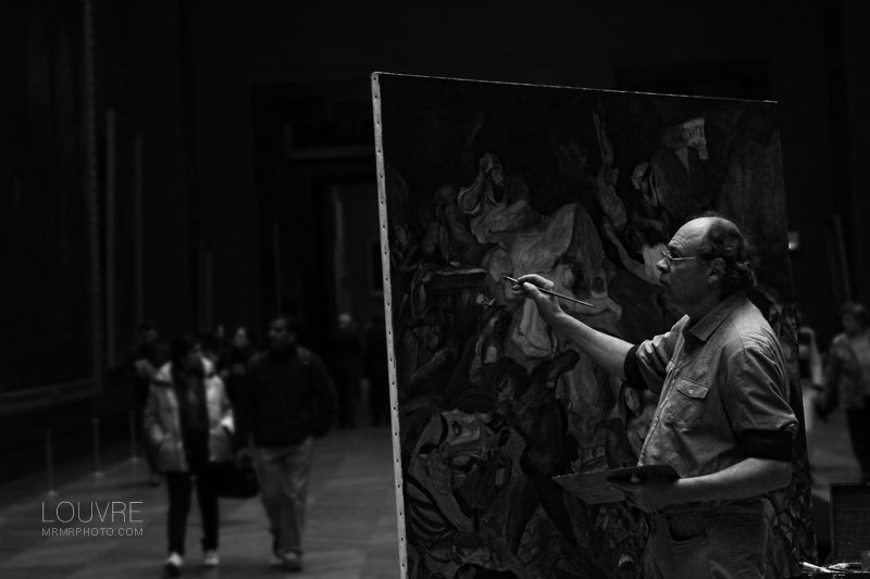 A painter in Louvre Museum