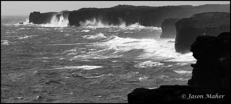 Waves crashing against the rocks in Hilo, Hawaii.