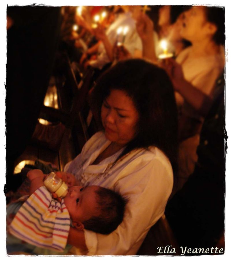 a woman and her baby on the candle light