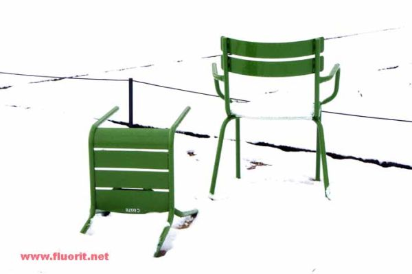 Two chairs in the snow in the Tuileries Gardens in