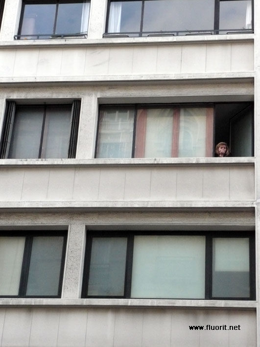 Woman at the window, waiting for someone