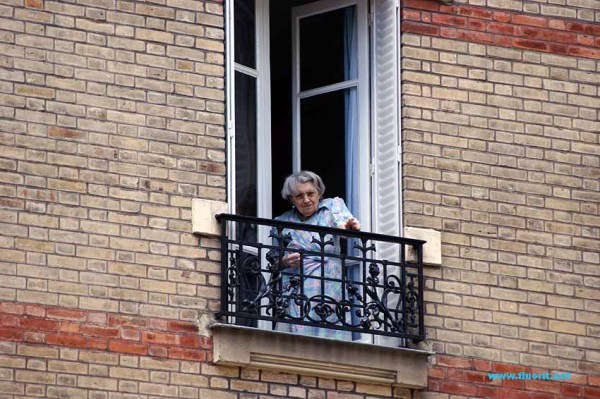 Old woman at her window