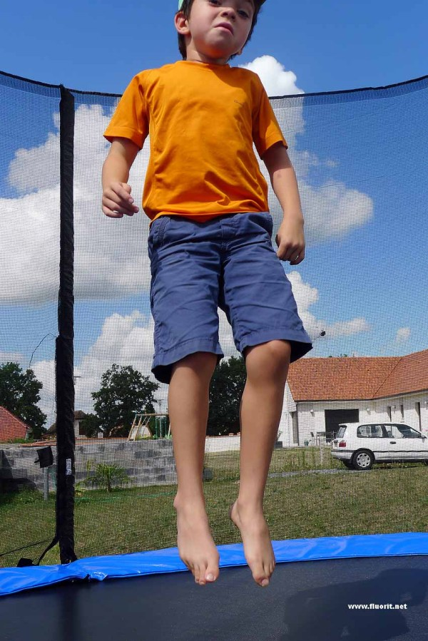 Kid jumping on a trampolino