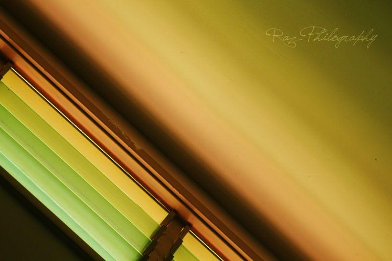 A shot of light coming through tinted windows.