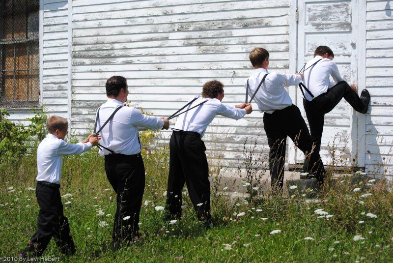 Groomsmen trying to open the door.