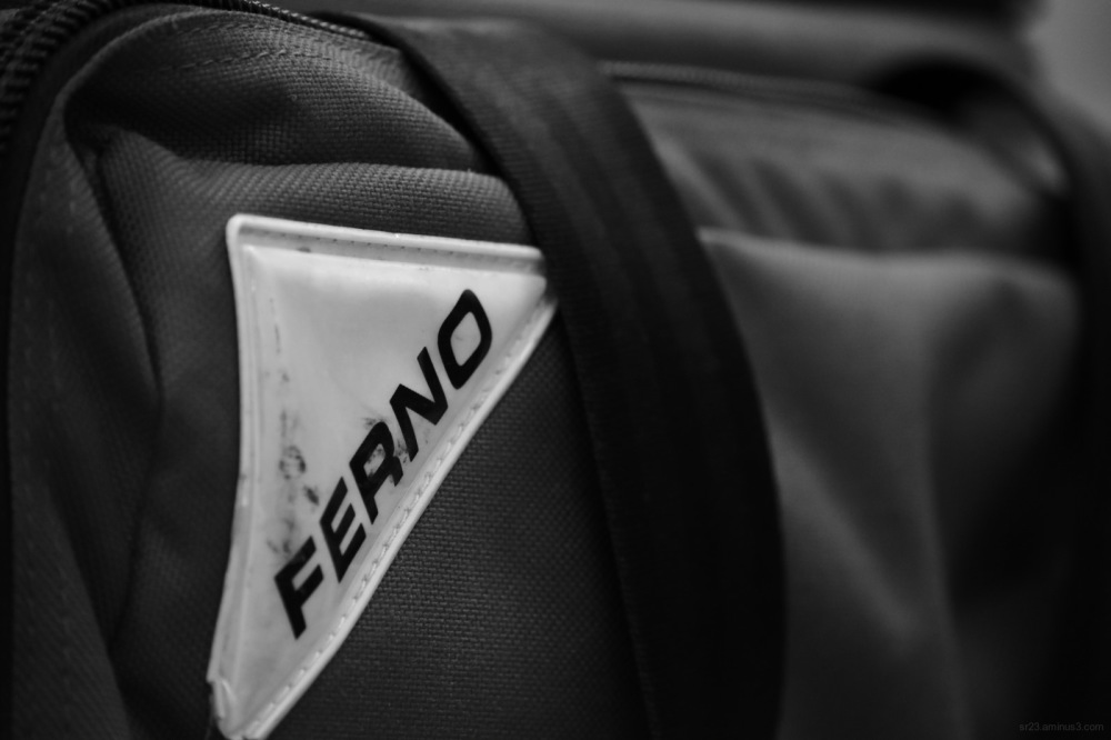 Black and white image of red Ferno EMS bag