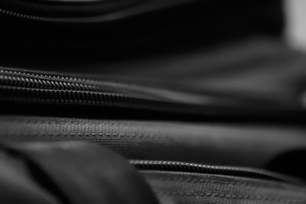 Black and white image of red Ferno EMS bag zipper