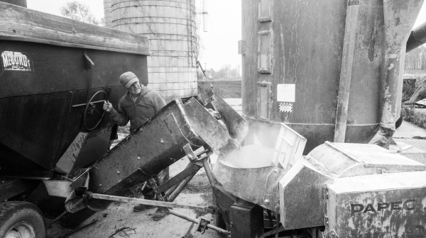 Man grinding corn on a fall afternoon