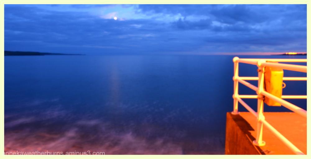 Moon rising and Sun setting