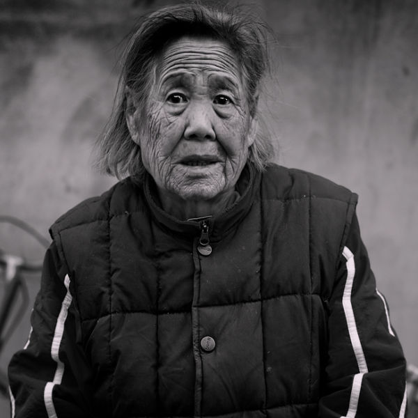 Old woman in Hutong, Beijing, China