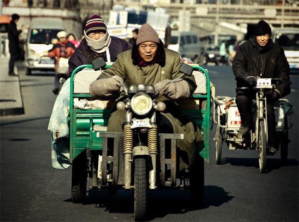 Man is driving rickshaw in Beijing street
