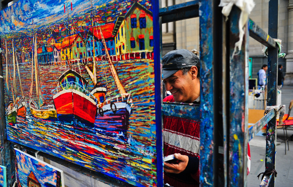 Chilean artist is making painting in Santiago