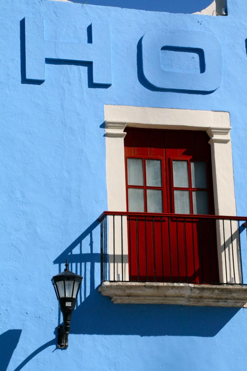 hotel campeche blue balcony red door