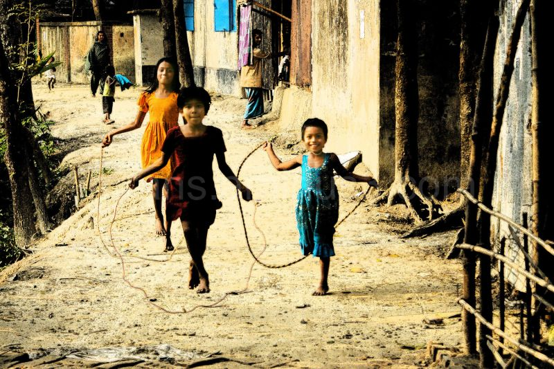 village girls skipping with tree roots