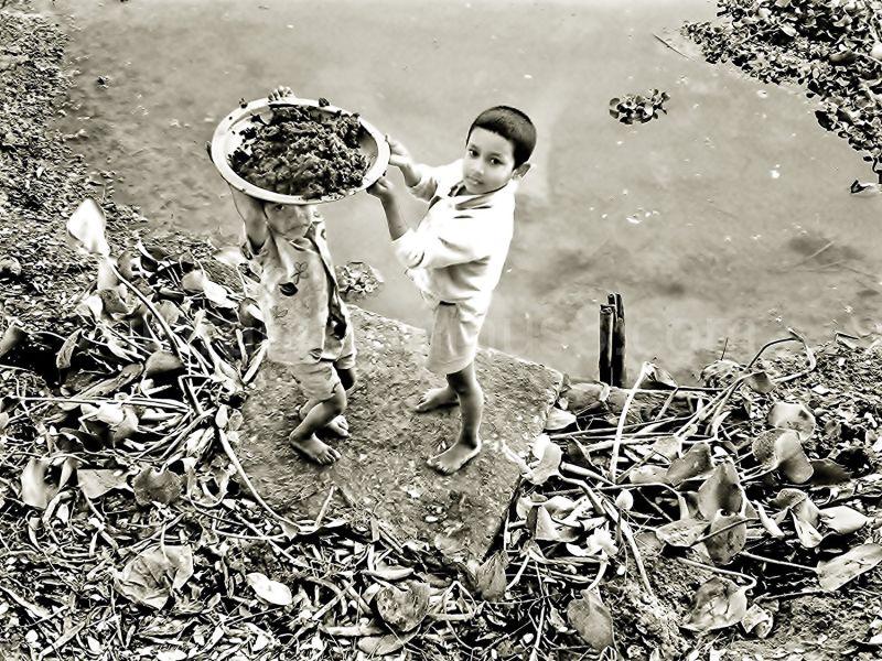 kids picking mud