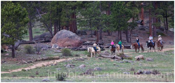 horseback riders on trail at RMNP