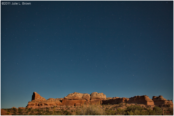 night sky with stars over canyon lands NP