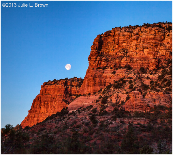setting moon over red rocks at sunrise sedona
