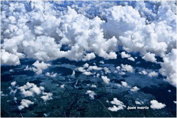 see the clouds adrift so far below