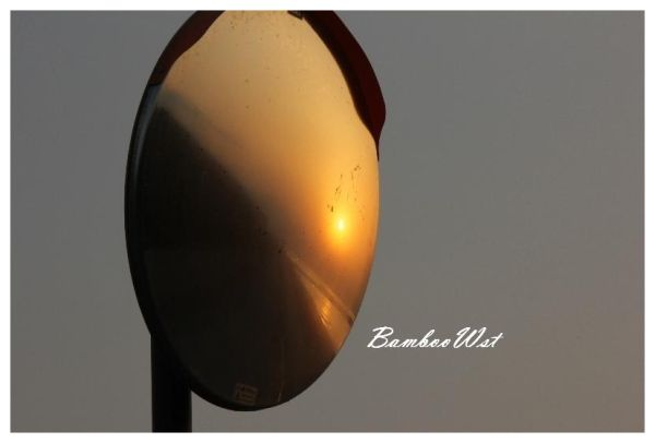 Sunset reflected in a mirror.