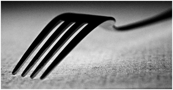 Blank and white macro shot of a fork