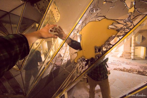 an abandoned love hotel's mirror wall