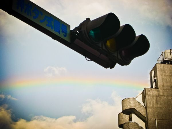 a traffic light with a rainbow
