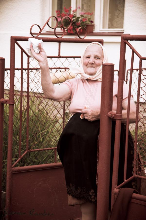 a traditionally dressed Slovak granma greeting