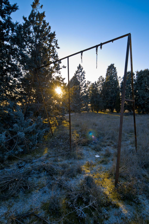 a broken swing in winter