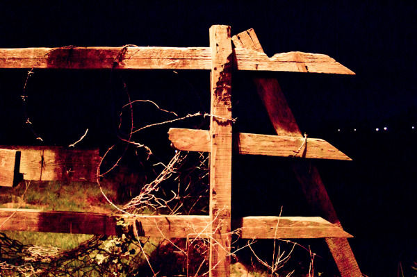 a fence in the night