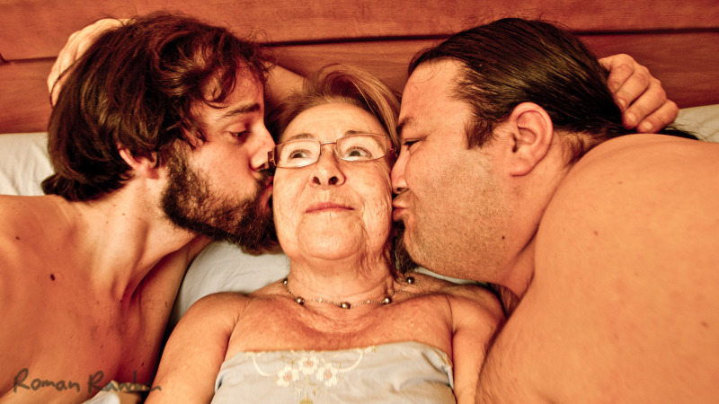 an old lady with 2 young lovers