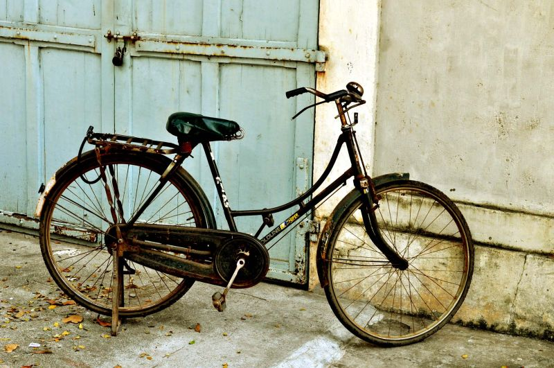 an old cycle by the gate