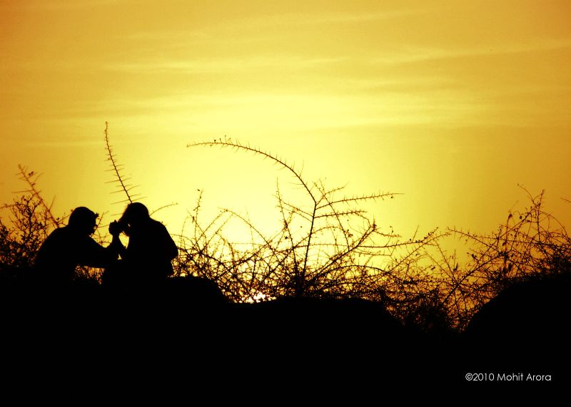Couple sitting on a hill at Garden of Five senses