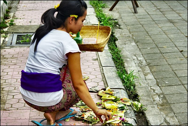 placing an offering in bali