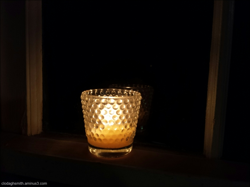 a candle in the window for the City of Light