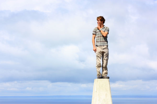 Man against blue sky