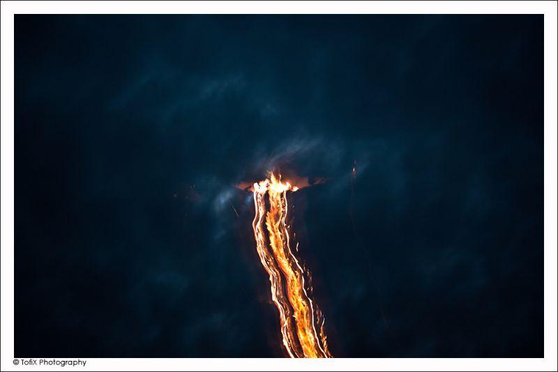 fire at a dark sky