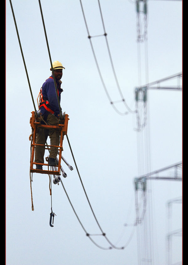 Workers in high-voltage wire 2