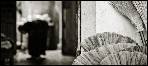 a vietnamese broom salesperson hanoi