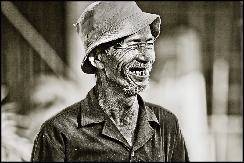 portrait of a vietnamese fisher man in Hoi An VN