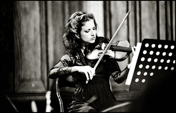 portrait of a woman plying violin