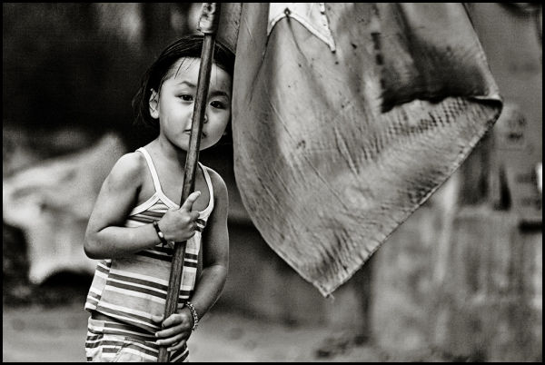 portrait of a vietnamese girl holding a flag