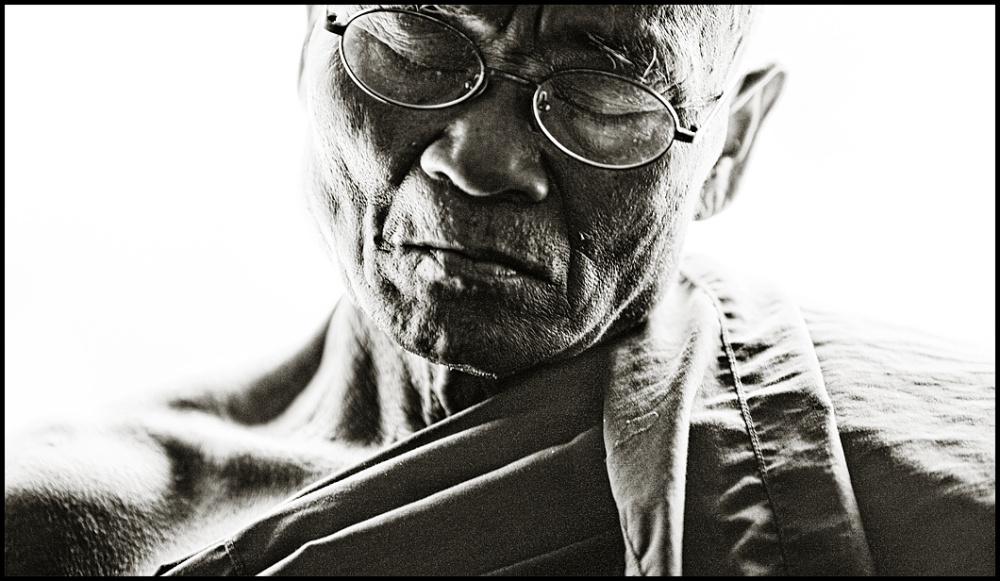 portrait of a monk on a train