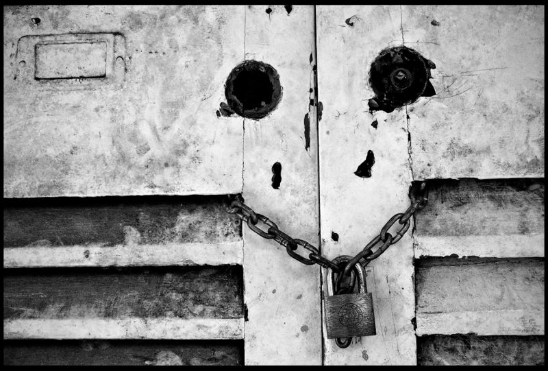 locked door of an abandoned house