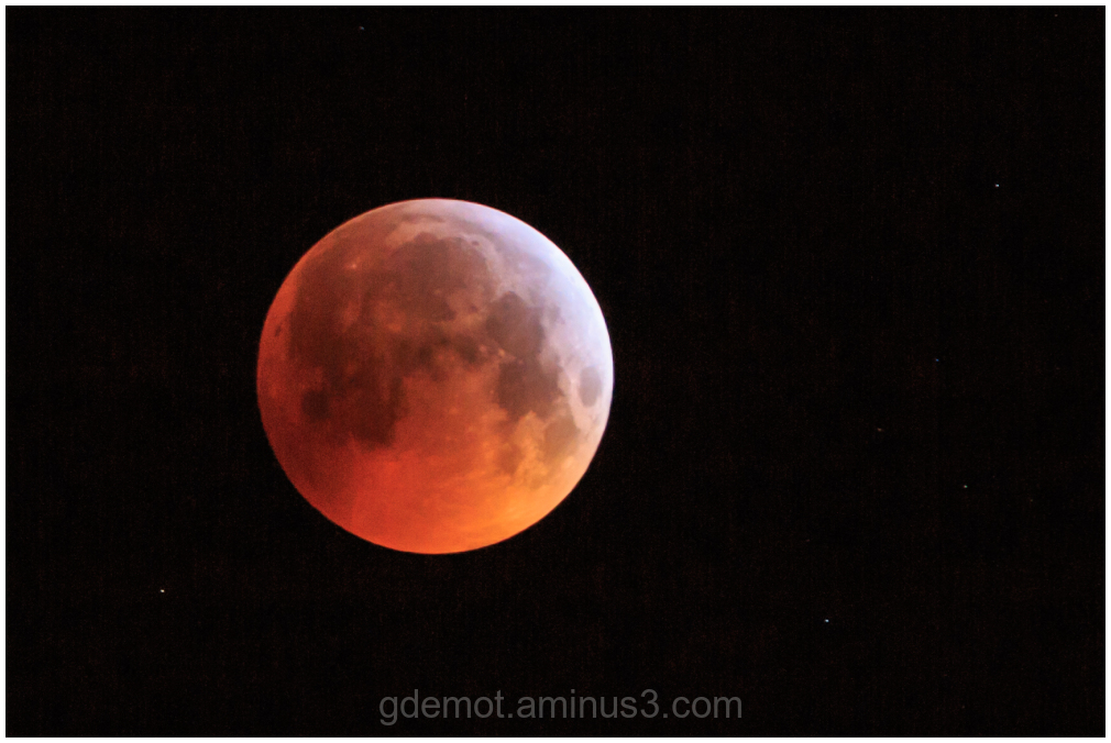 A total lunar eclipse  called a Blood Moon