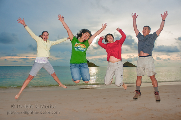 leap of joy on Lanikai Beach, Hawaii sunrise