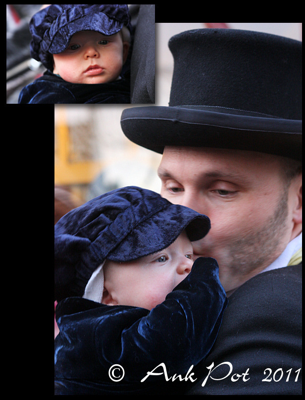 Father kissing child at Dickens Festival